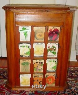 Antique L. L. May country store seed display case cabinet with product-15639