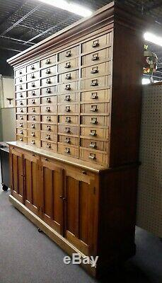 Antique Store Display Cabinet. 50 drawers. 4 Shelves. 2 Work Boards. 79.5Hx78W